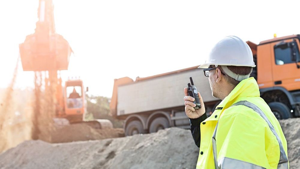 Construction worker using two-way radio
